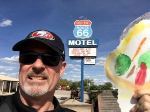 Me holding a large lollipop my granddaughter, Payton, gave me the day before I left.